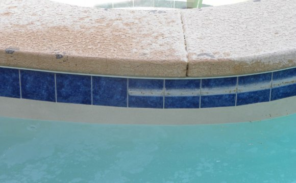 Cleaning swimming pool tiles
