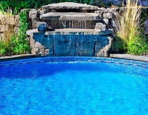 Image of a stone slow streaming waterfall in a pool in Frisco.
